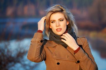 Blond woman against an autumn nature landscape