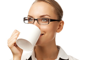 girl is drinking from a white mug