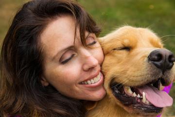 woman hugs her dog