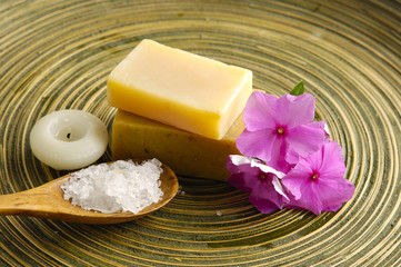 frangipani flower and salt in spoon on wooden texture