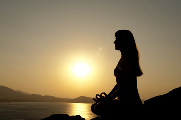 yoga pose silhouette at sunrise