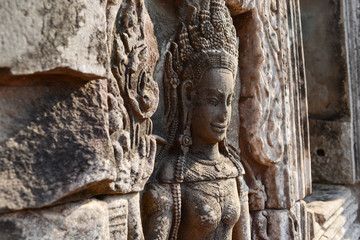 Aspara art of angkor wat temple ruins camboida