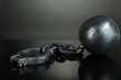 Ball and chain on grey background