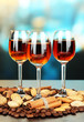 Glasses of liquors with almonds and coffee grains,