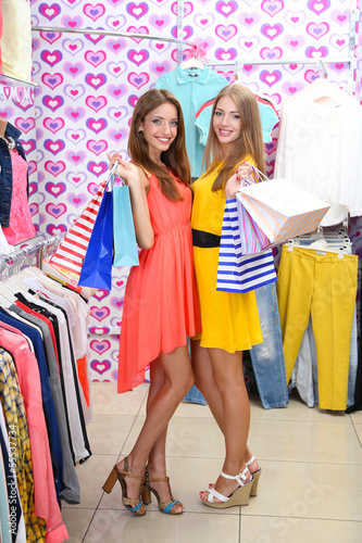 Two beautiful young woman in shop