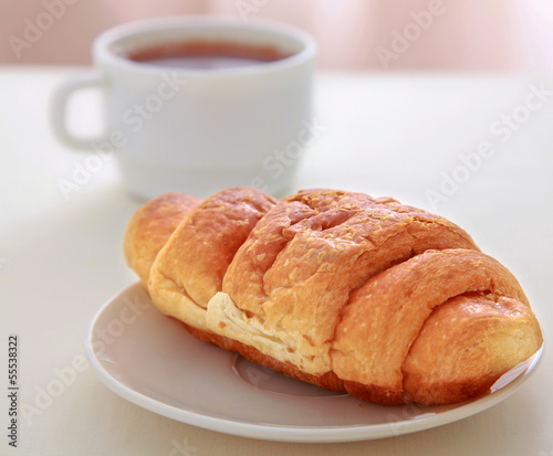 Croissants, coffee, on wooden table