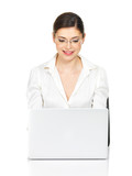 woman sits from the  table with laptop in white shirt