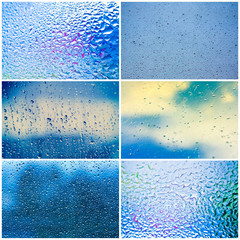 Drops Of Rain On Blue Glass Background.