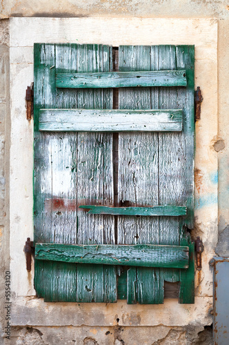 Old green wooden window blinds