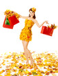 Autumn woman with shopping bags in dress of maple leaves. White