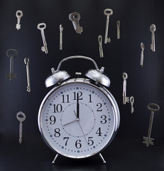 Old-fashioned clock with hanging keys