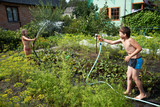 Children with garden hoses