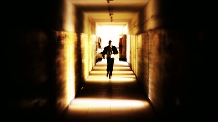 Stressed businessman running away looking back light HD