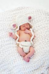 Newborn Baby Wearing a Lamb Costume