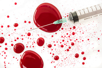 syringe with blood splash