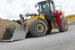 Driver opening cab door to  bulldozer  on construction site