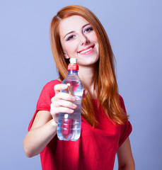 Sport woman with bottle.