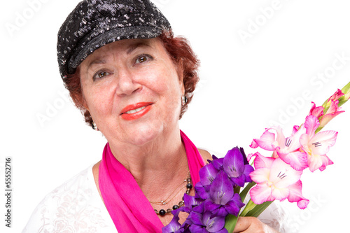 Senior Lady With Black Hat and Gladious Flowers