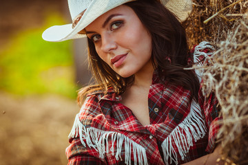 cowgirl model posing on farm