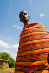 Masai with traditional colorful Masai blanket