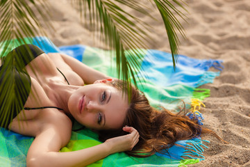 woman wearing bikini lying on cover