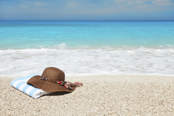 Hat and towel on a beach