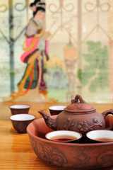 Chinese traditional teapot with cups of tea