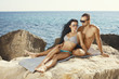 Perfect bodies couple posing on the coast
