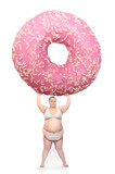 Overweight woman with big pink donut. Weight loss concept.