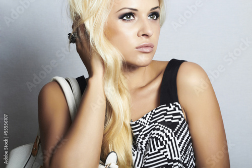 fashionable beautiful blond woman with with handbag. shopping