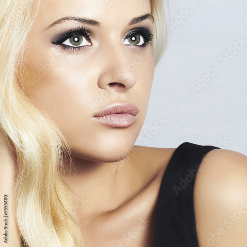 close-up beautiful blond girl with green eyes. beauty woman