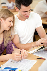 Student couple looking at tablet pc