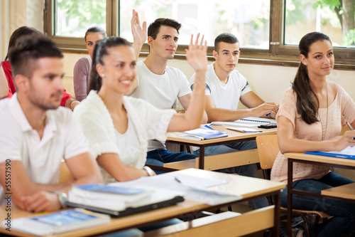 Students in class asking questions