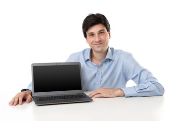 handsome young businessman displaying laptop