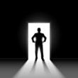 Silhouette of man standng in doorway.