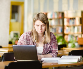 girl using computer in a library