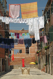 typical outdoor drying laundry on clotheslines in Venice