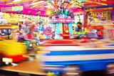 Fototapety Karussell auf dem Jahrmarkt - Langzeitbelichtung