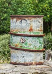 Old rusty steel barrel for fuel.