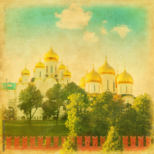 Grunge image of golden domes in the Moscow Kremlin.