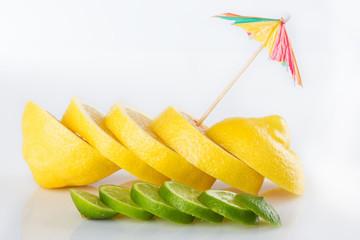 Row of juicy yellow lemon sliced wheels with straw