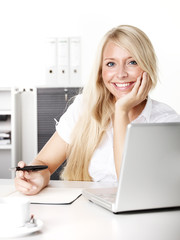 Female office assistant at work