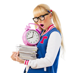 Surprised girl holding books and clock