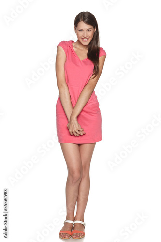 Full length of smiling young female