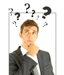 Young man thinking surrounded by question marks isolated