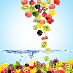 Flight fruits and berries in water on blue background