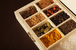 Wooden box full of spices