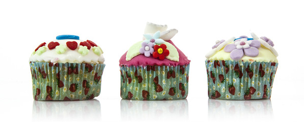 Three tasty cupcakes isolated on white background