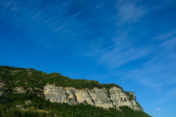 cirrus over cliff
