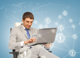 businessman networking with laptop